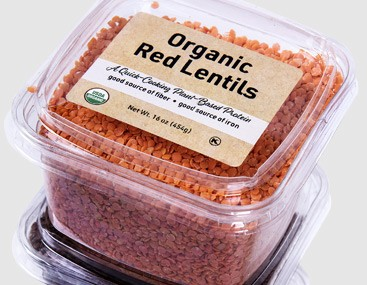 On-trend bulk essentials and ingredients - container of red lentils