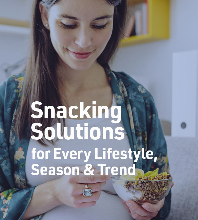 Snacking Solutions for Every Lifetyle, Season and Trend. Woman eating snack blend.